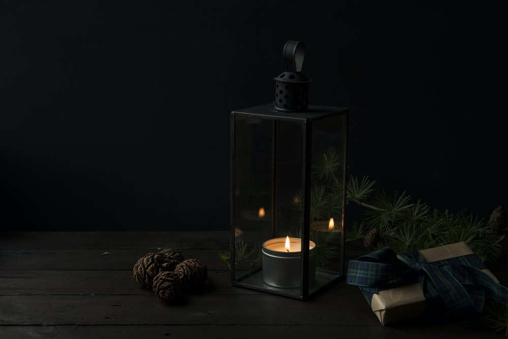 tealight candle with rack inside glass lantern