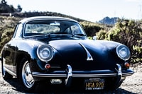 selective focus photography of classic black coupe