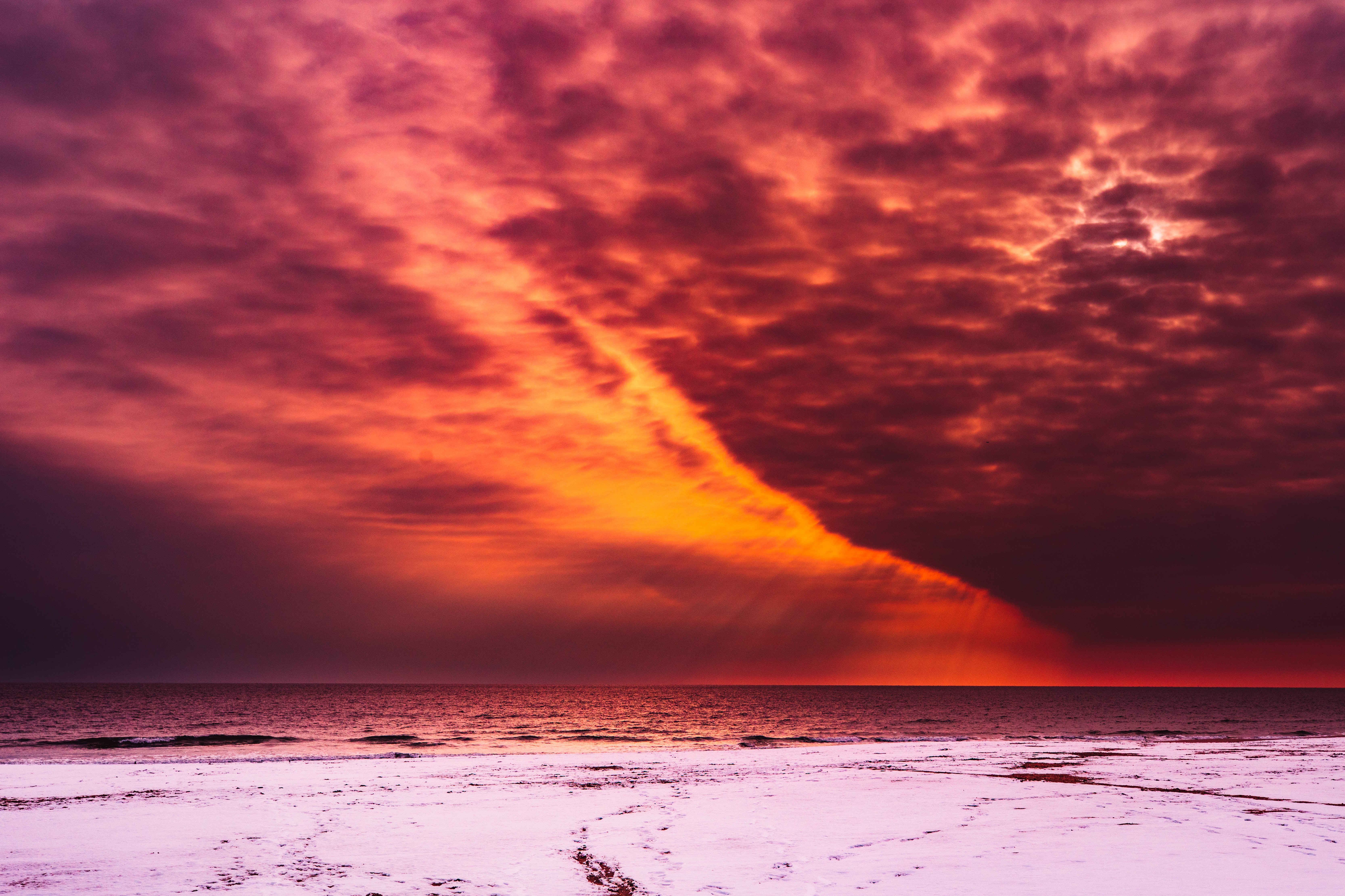 sea and red sky during daytime