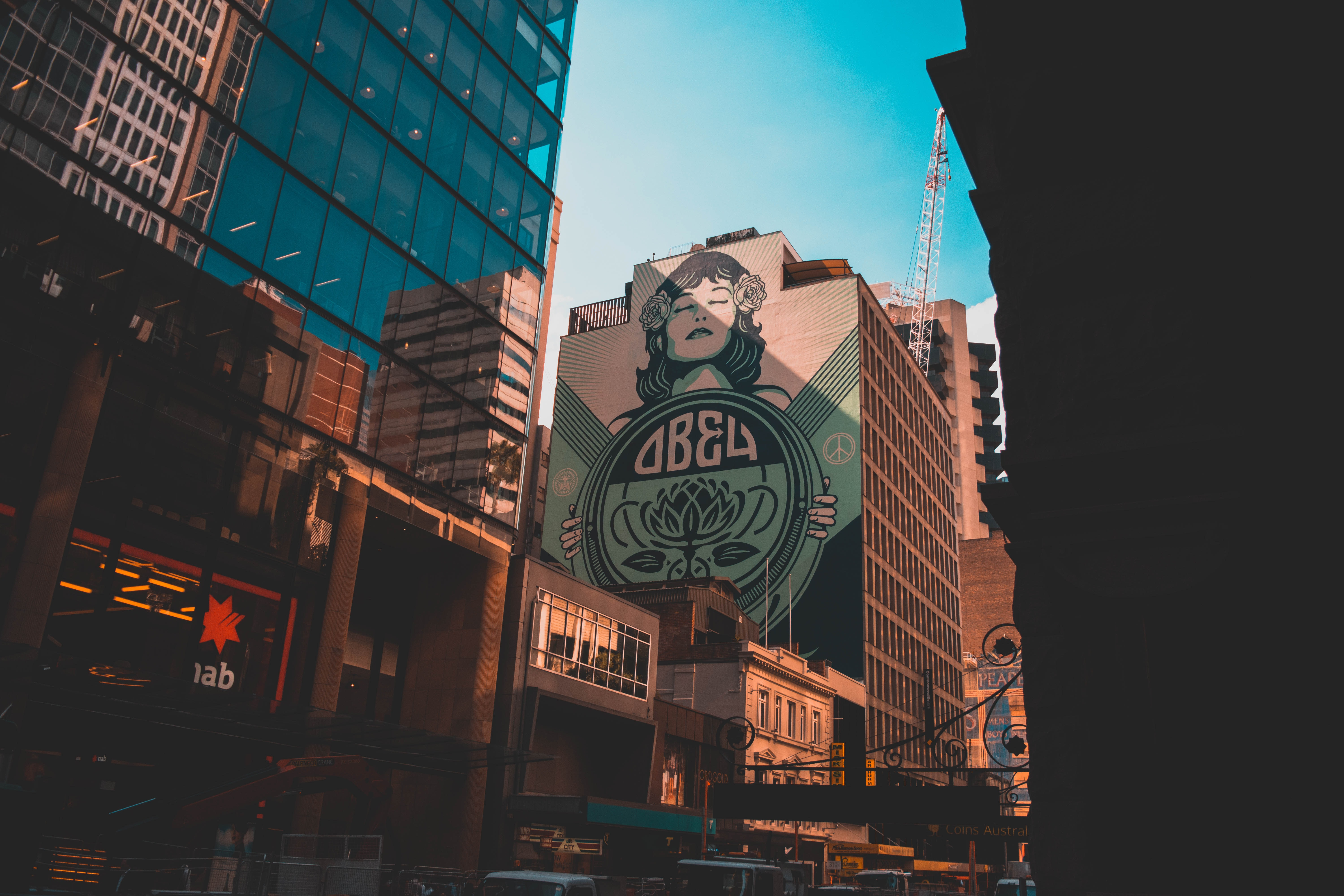 Obey billboard on brown building low-angle photography at daytime