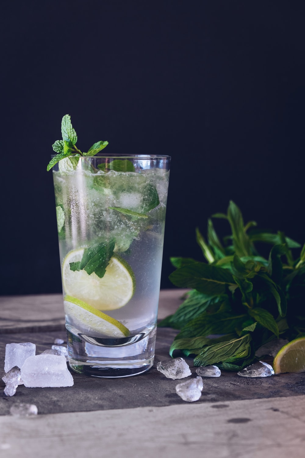 clear glass cup filled with water and lemon
