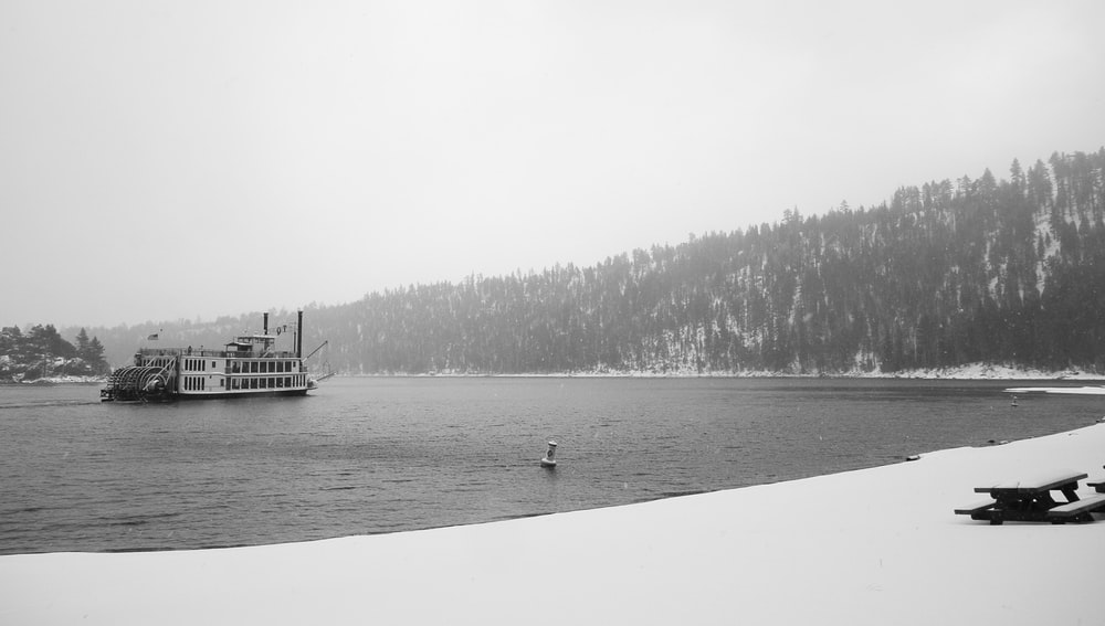 grayscale photo of ship on body of water