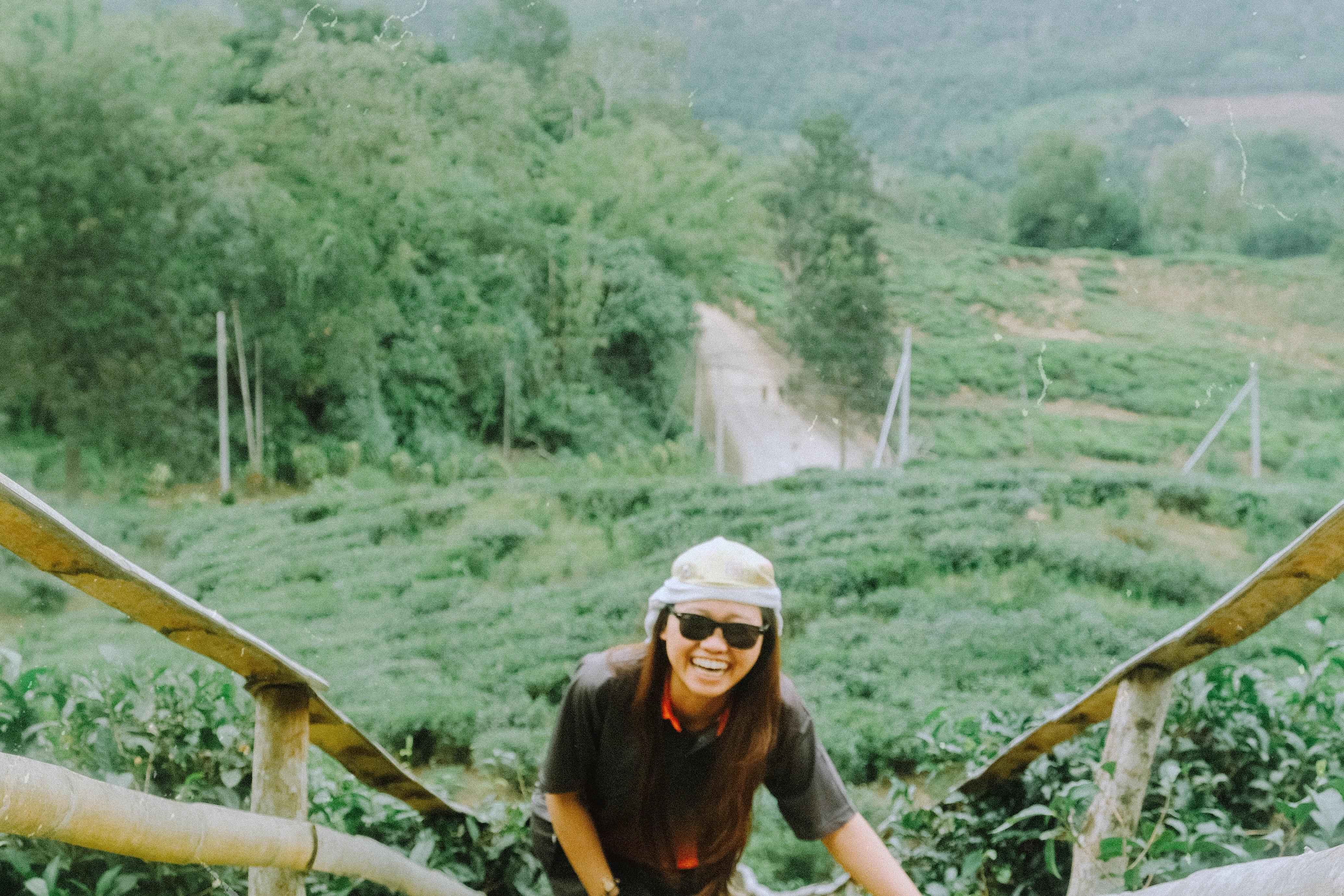 woman wearing black shirt smiling during daytime photography