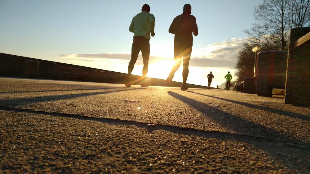 two men running at park