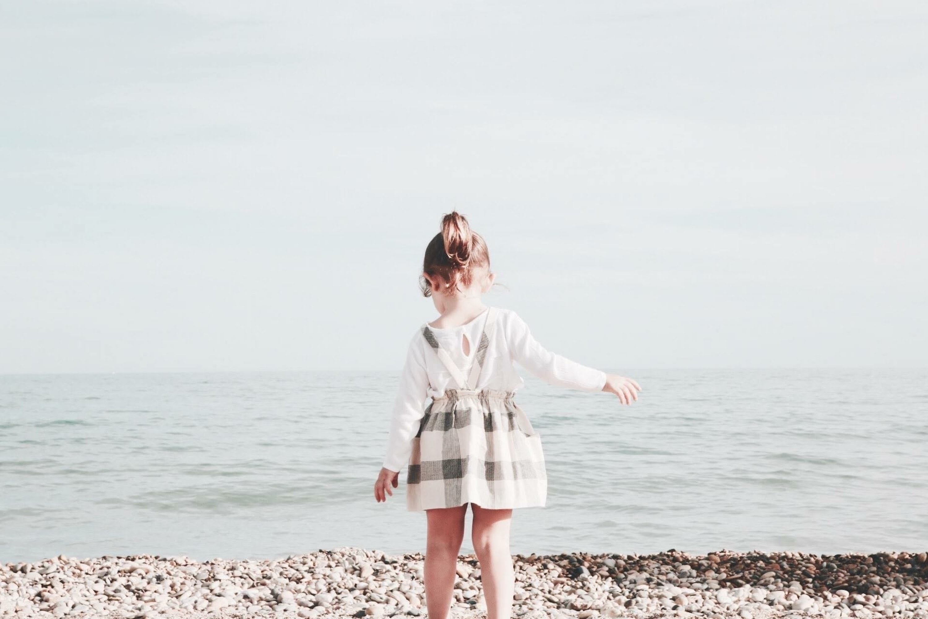 girl walking towards the sea