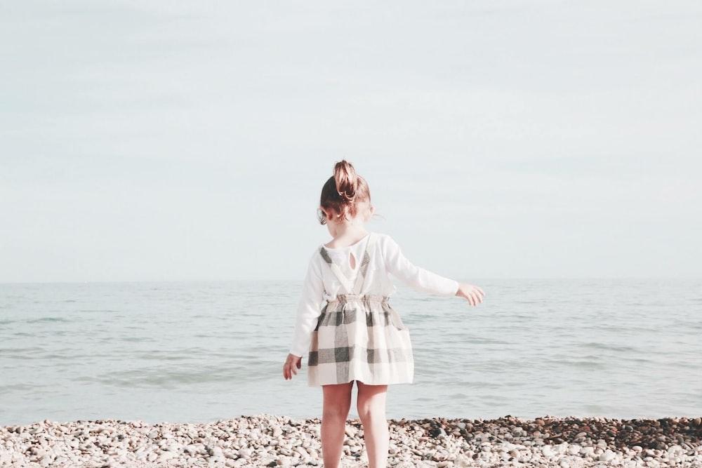 girl walking towards the sea