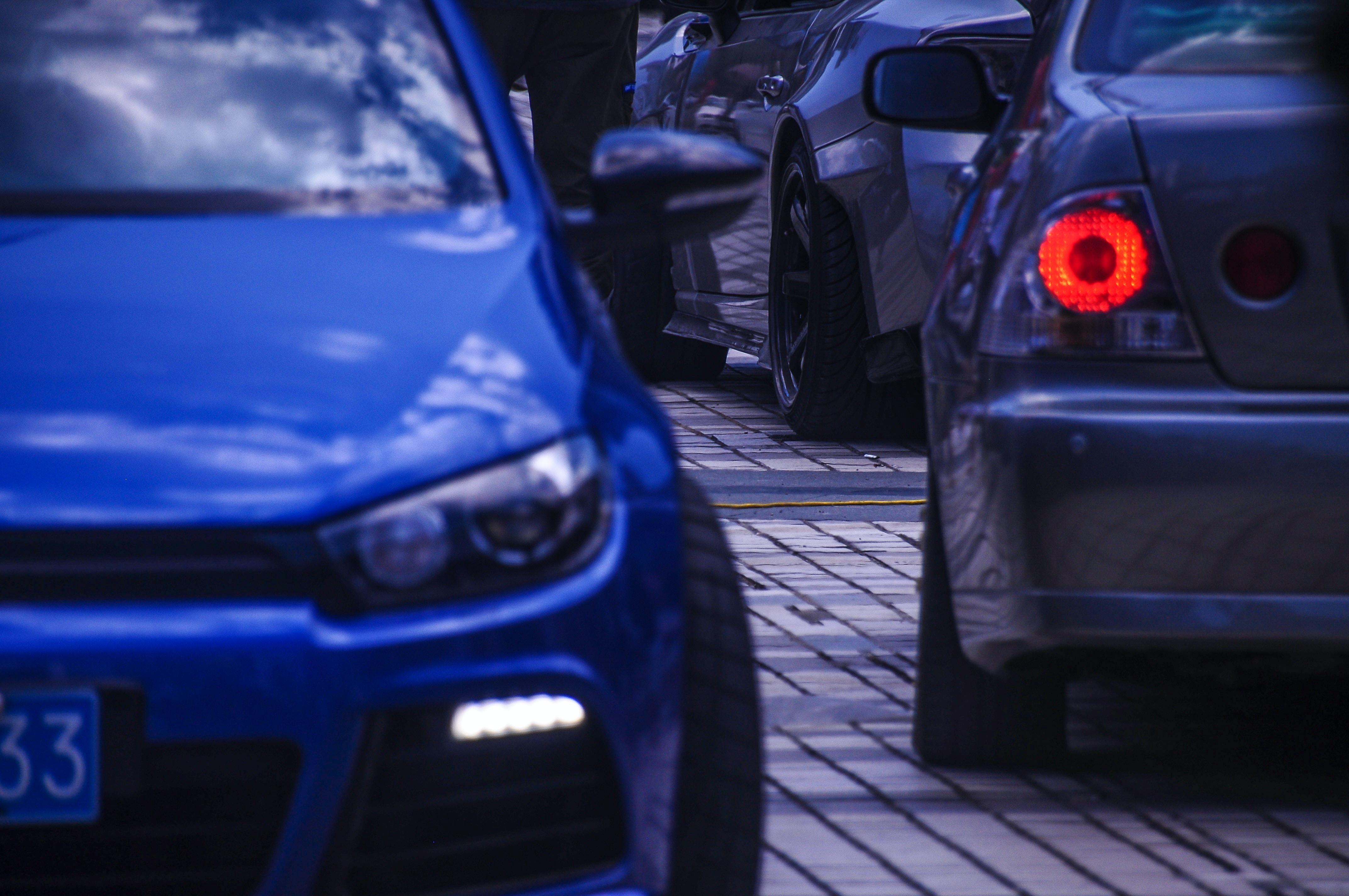 cars on bricked road