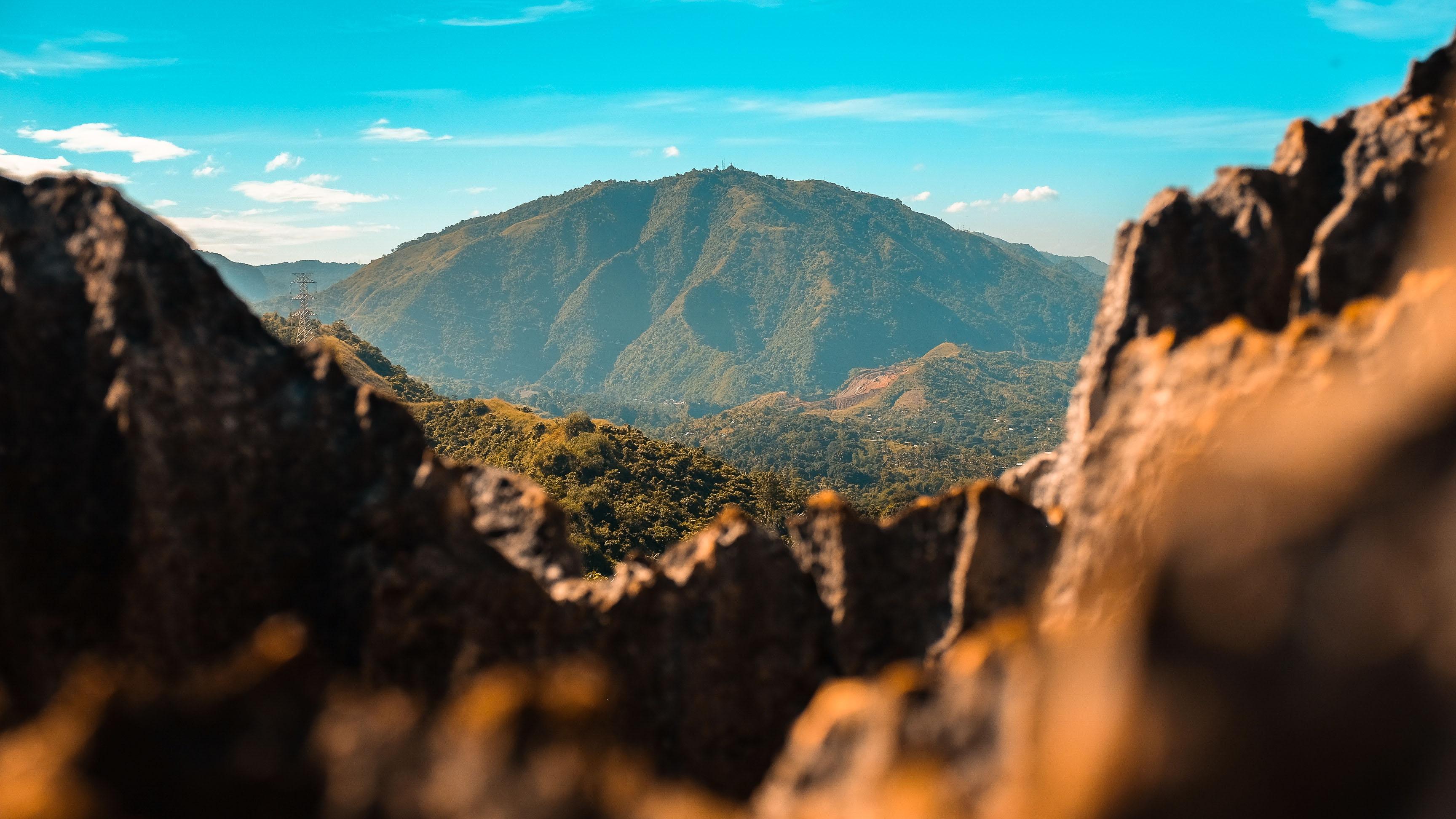 brown rock mountain near mountain