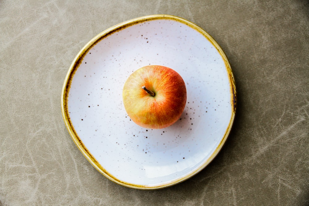 Apple on white plate