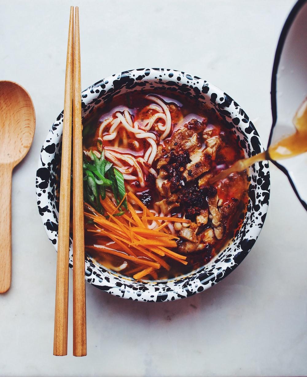 bowl of noodle ramen with chopsticks