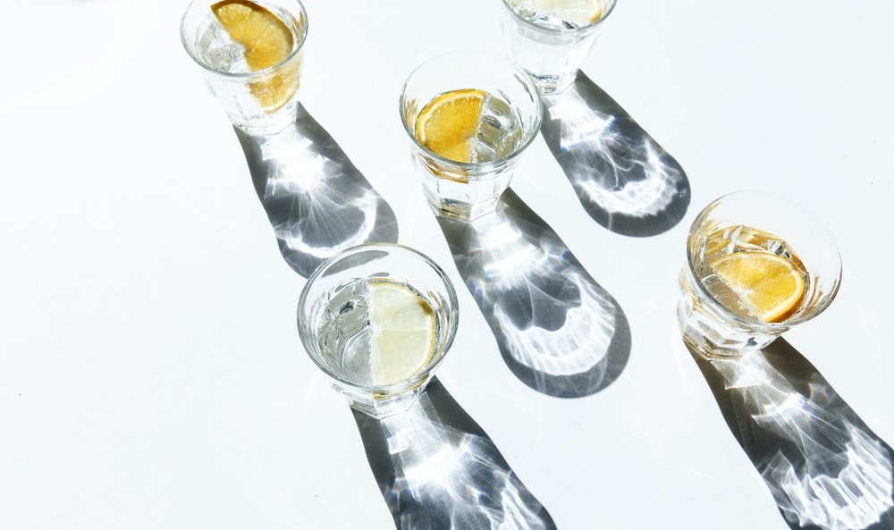 five clear shot glasses