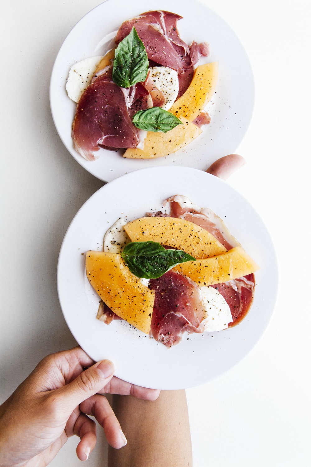 two raw meats on white ceramic plates