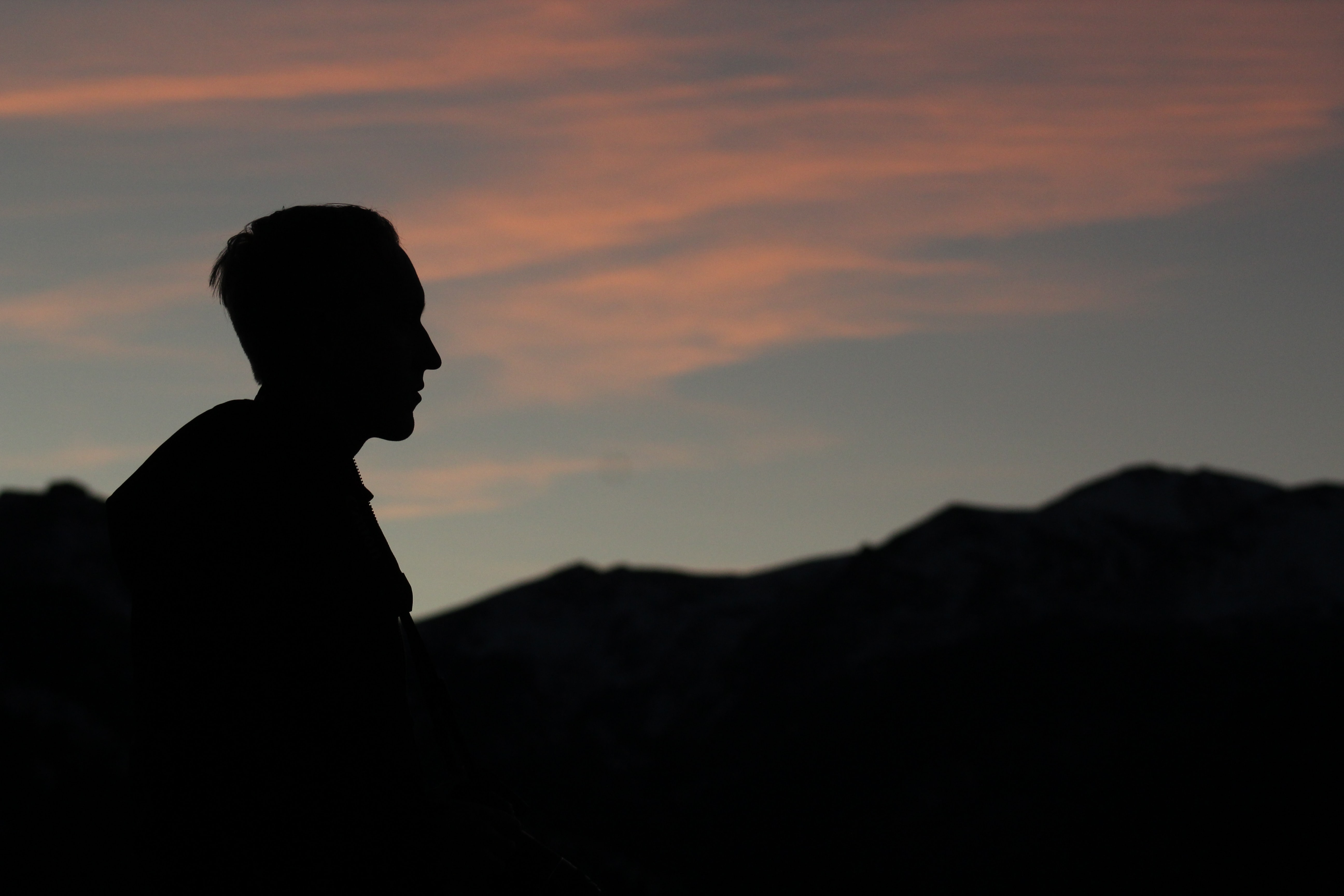 silhouette of man during twilight