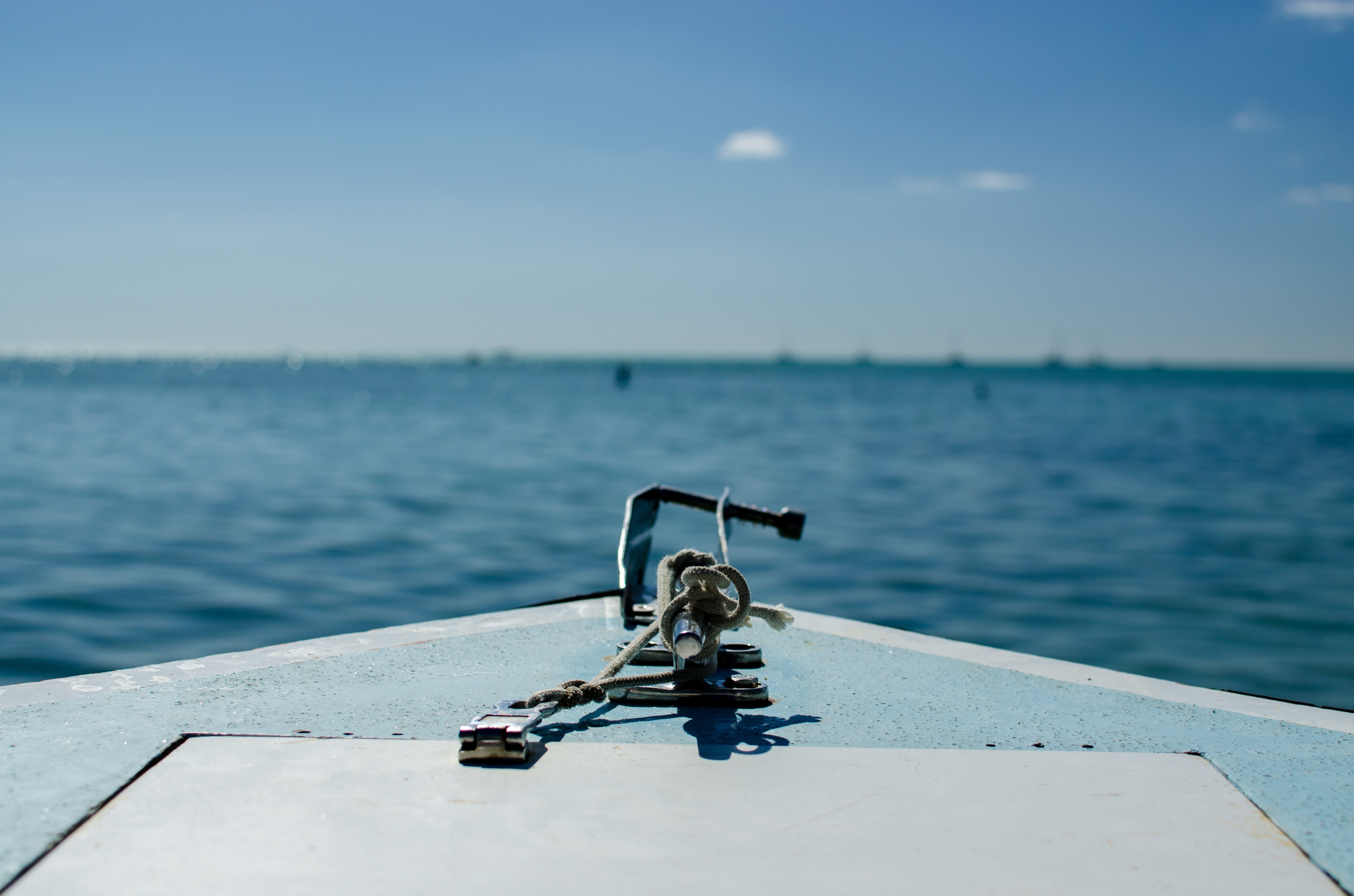 selective focus photography of black rod on boat