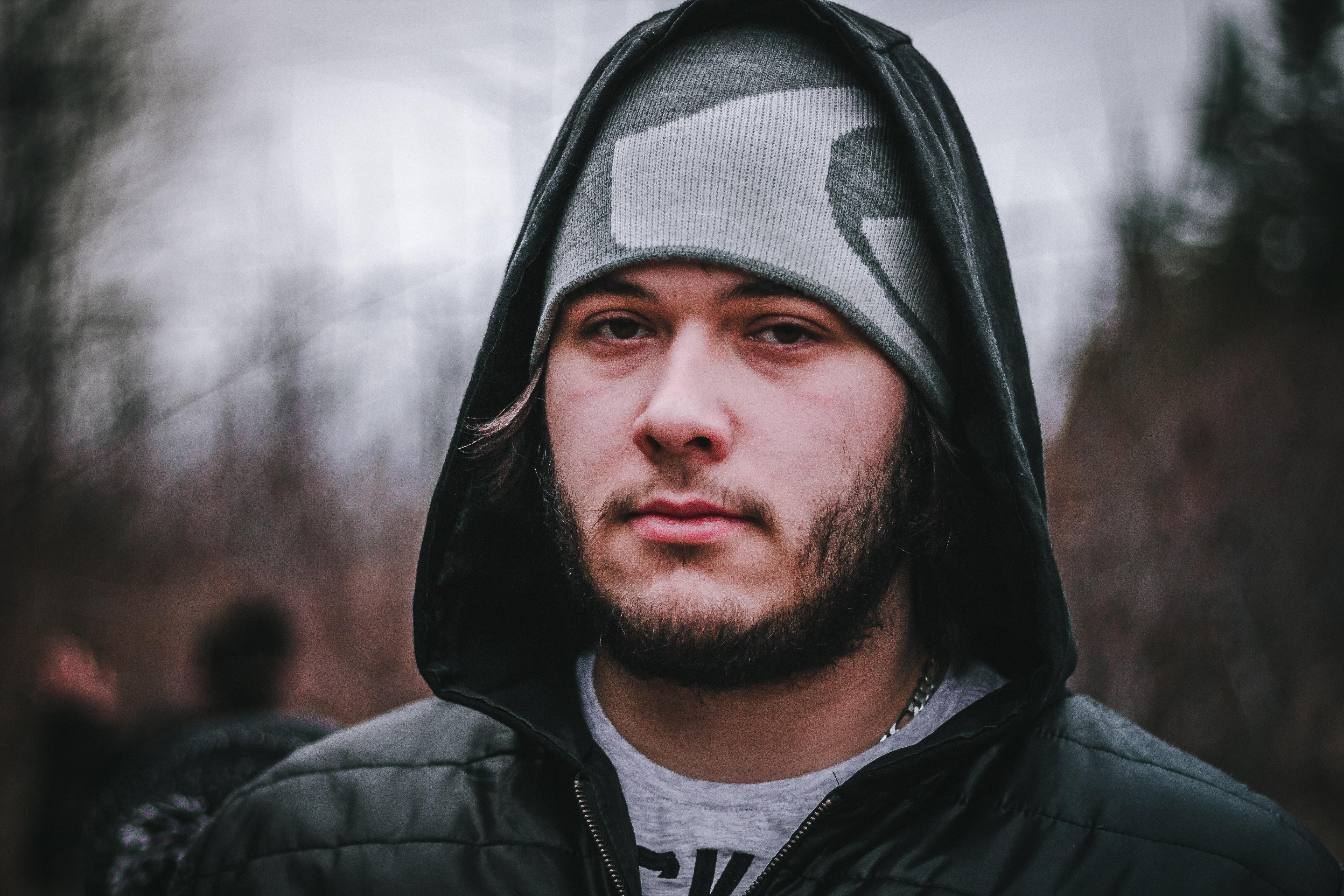 man wearing gray knit cap