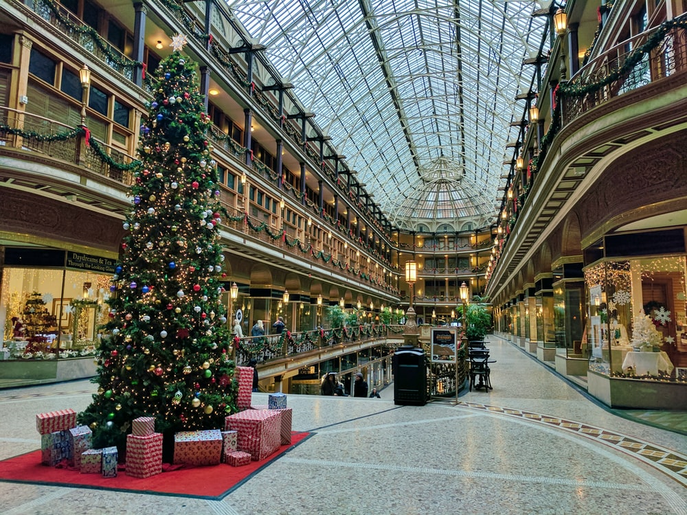 state of the art building interior with lit Christmas tree
