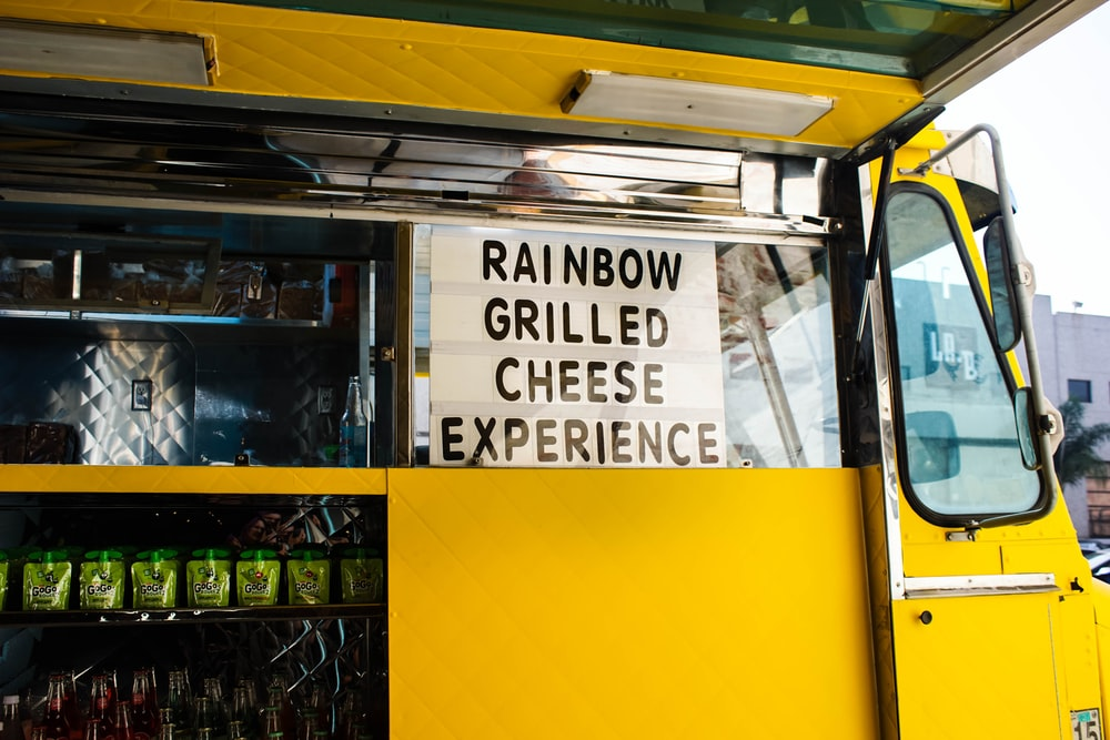 rainbow grilled cheese experience signage