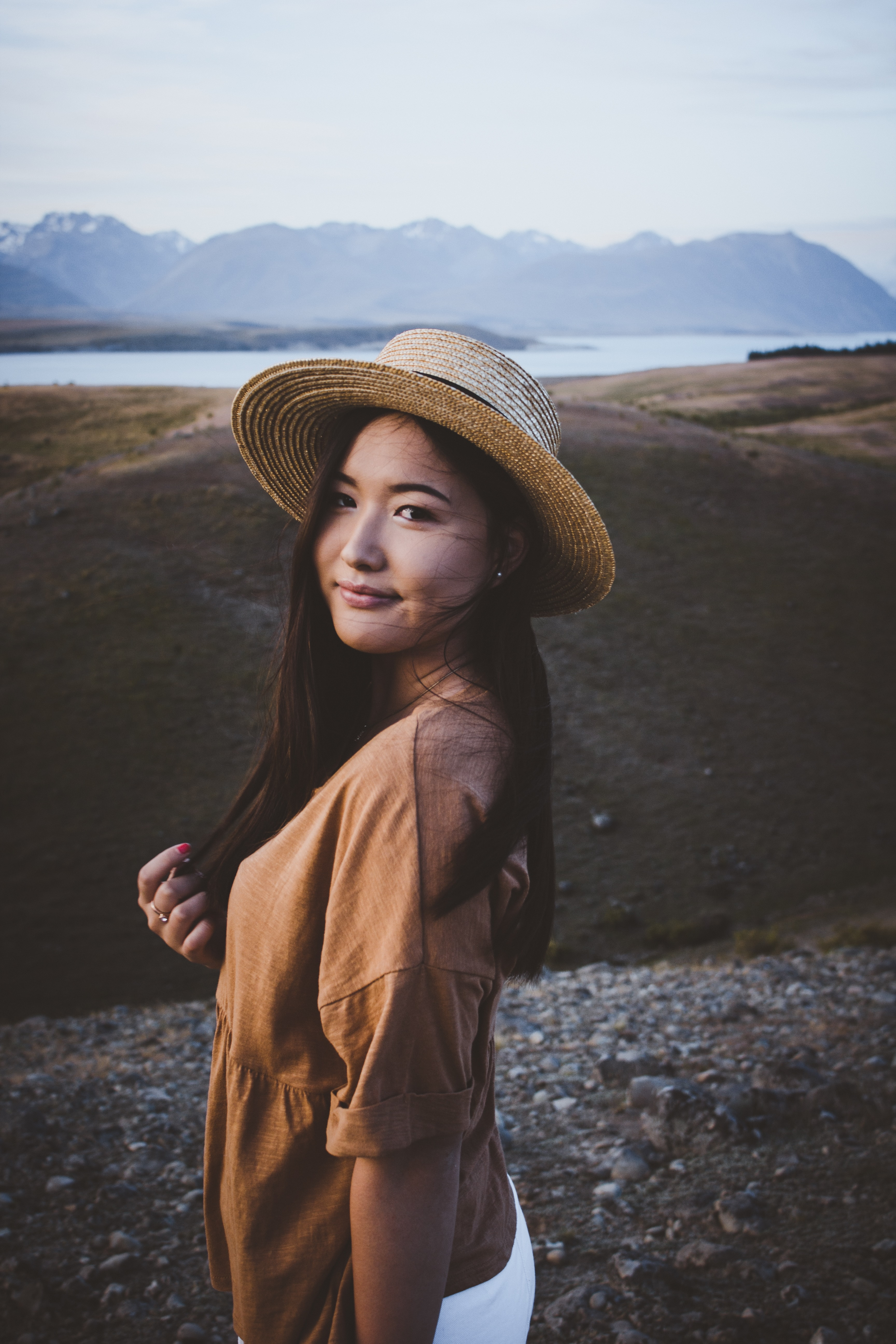 woman standing near brown mountain
