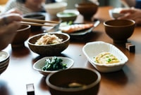 cooked food on plates and bowls