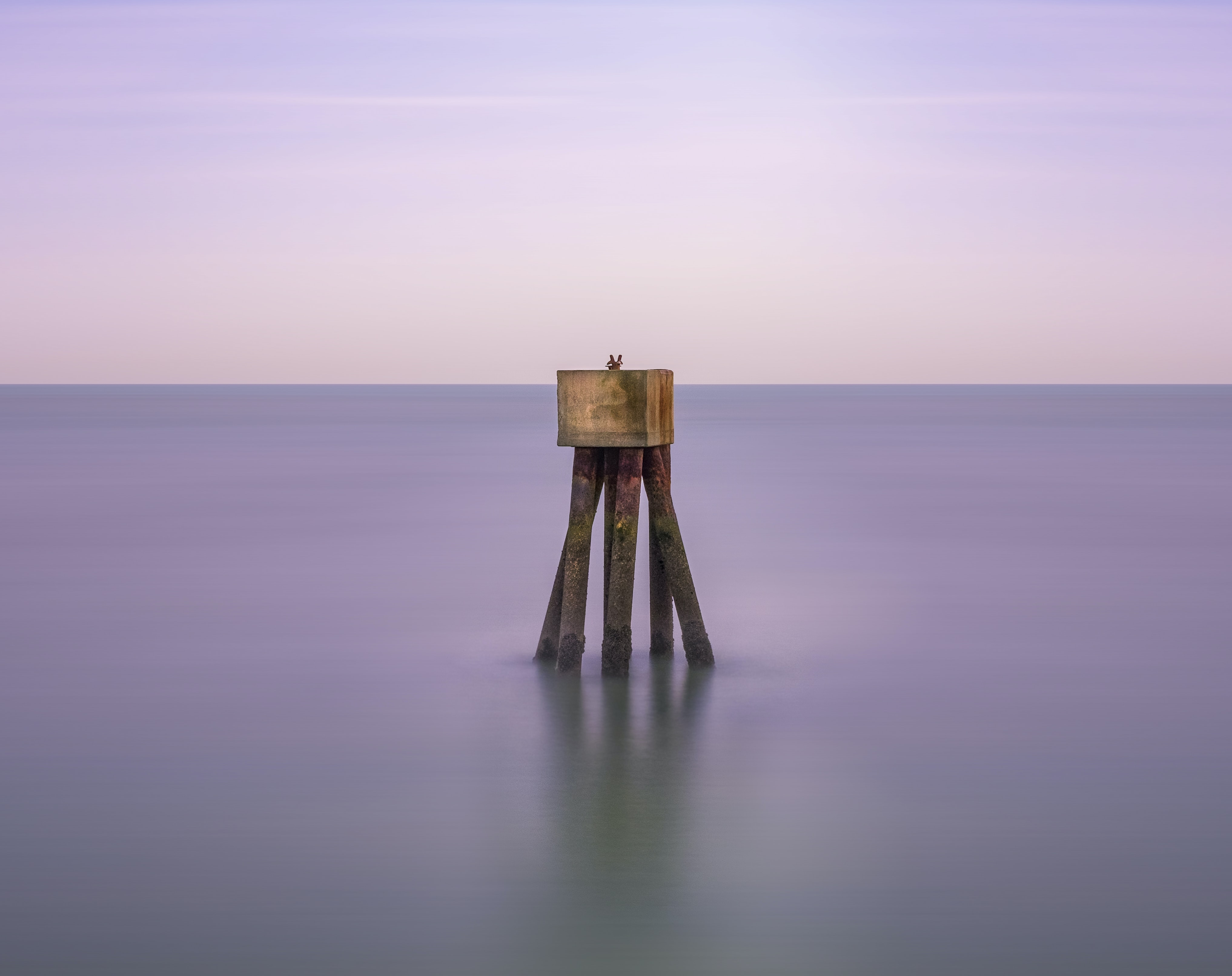 brown wooden sea stand during daytime