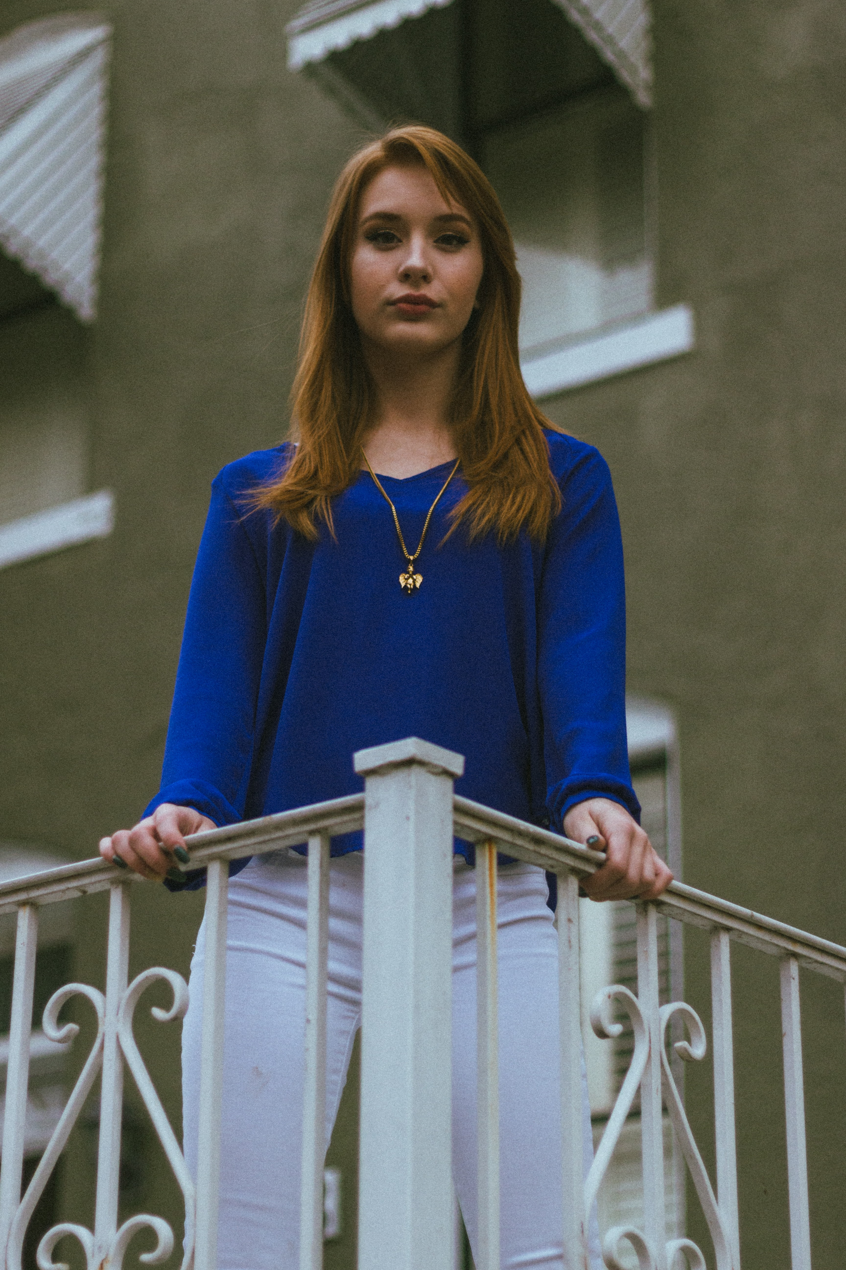 selective focus photography of woman standing on terrace