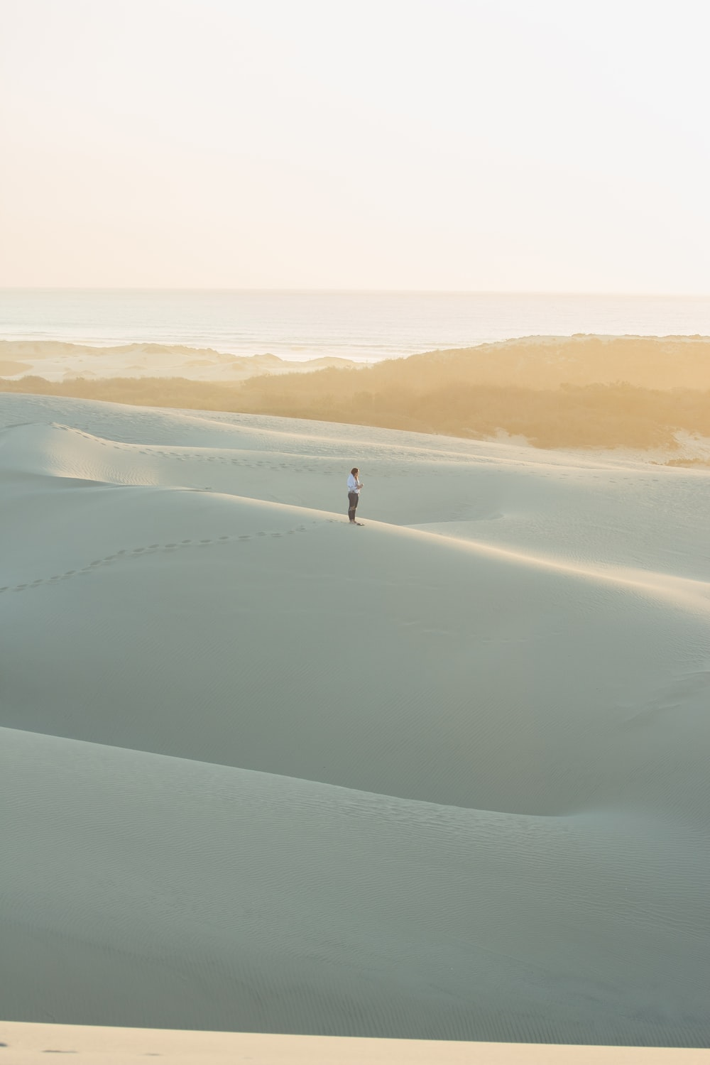 person standing on sand