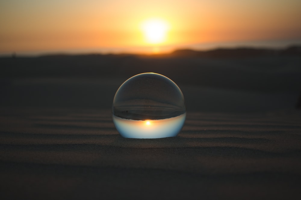 inverted view of sunset through a glass ball