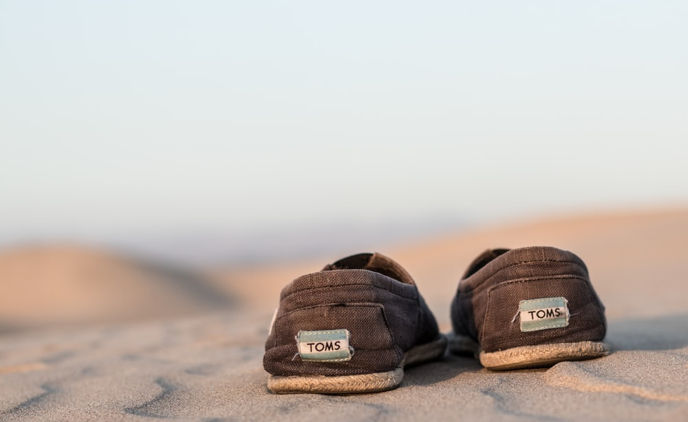 pair off black Toms shoe during daytime photography