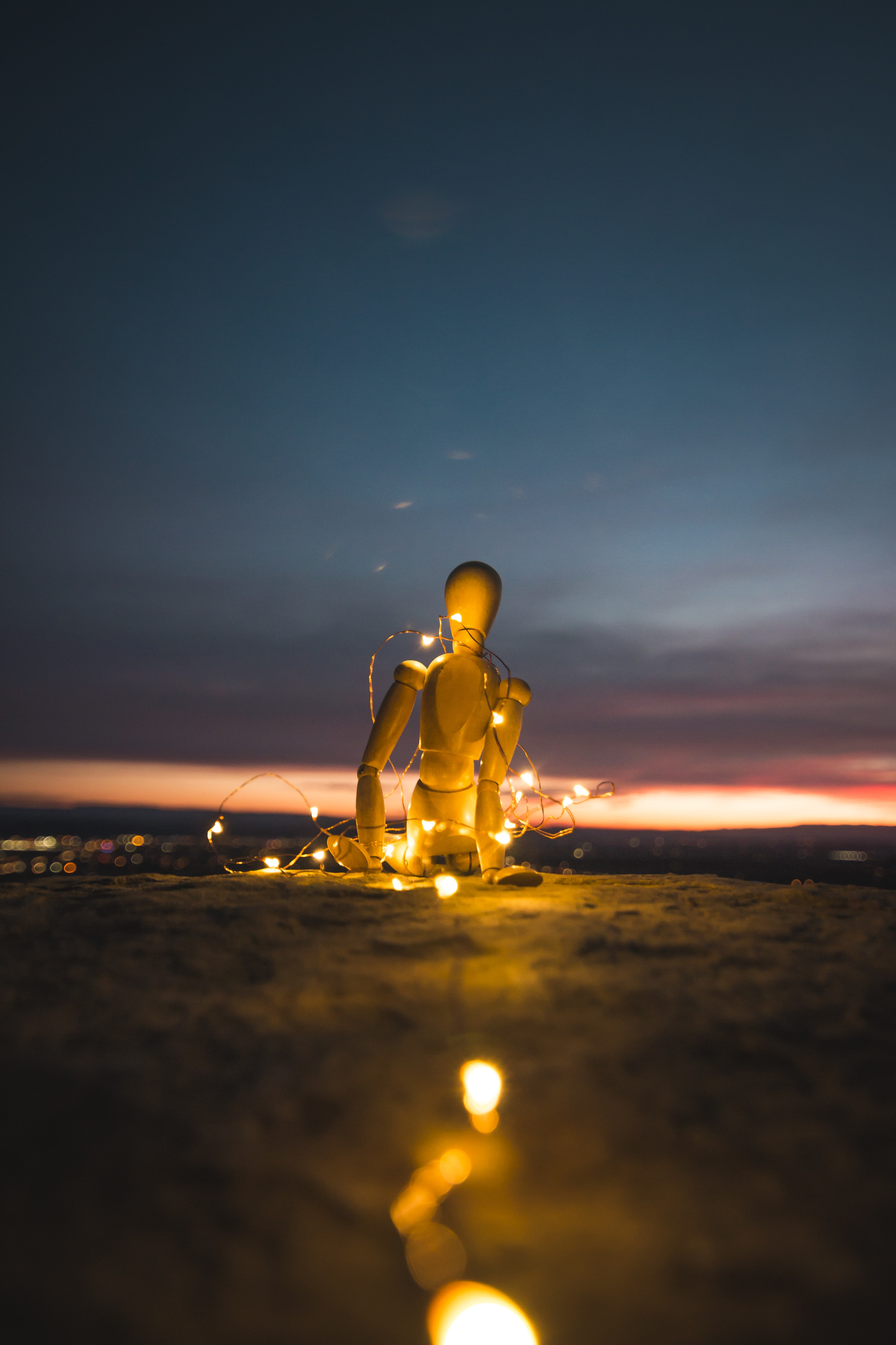 marionette doll on stand with LED string lights