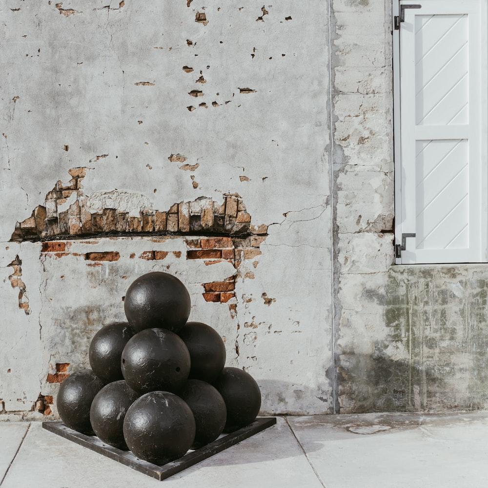 pile of round black balls