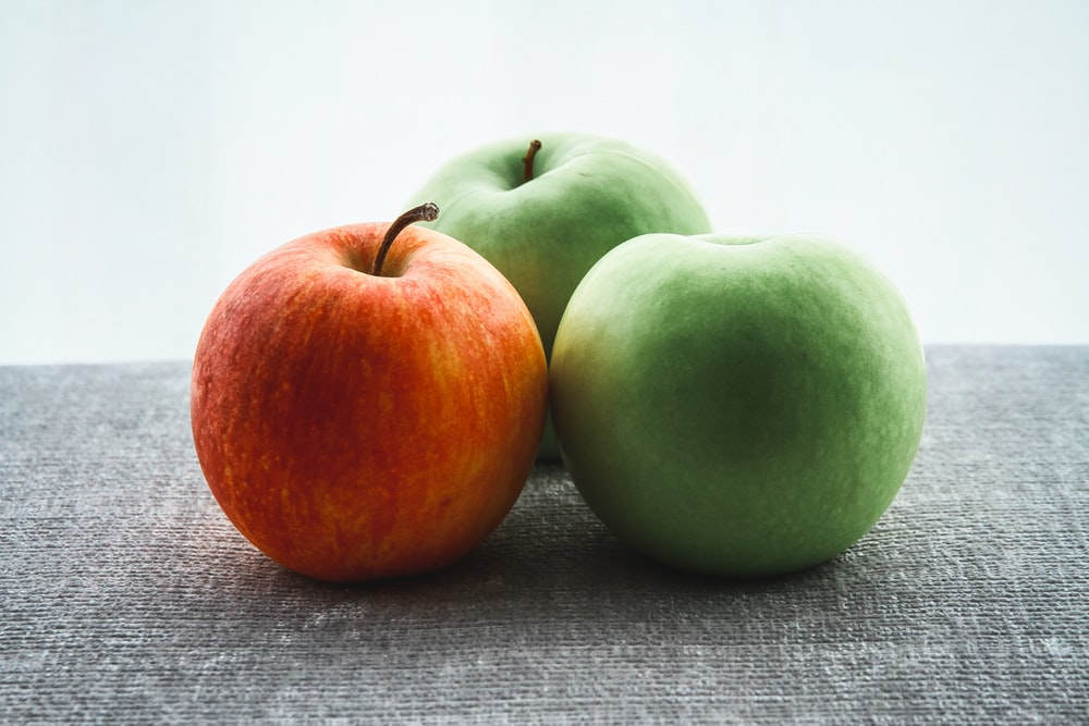 three green and red apple fruits