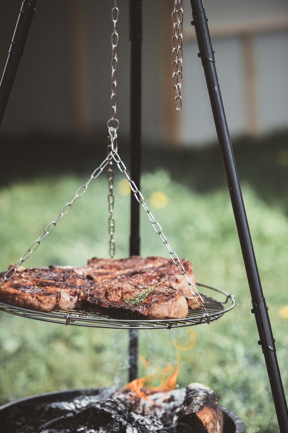 three grilled meat on silver steel grill