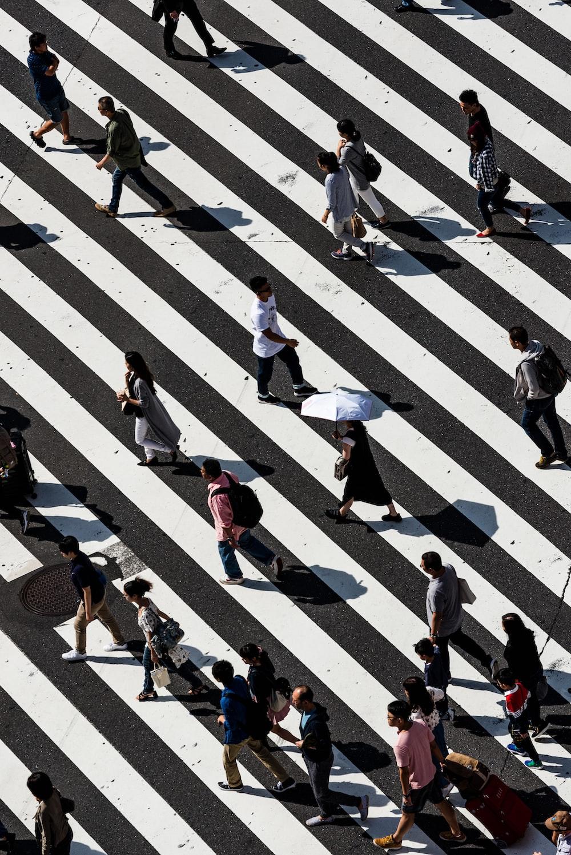 peoples walking on pedestrian lane