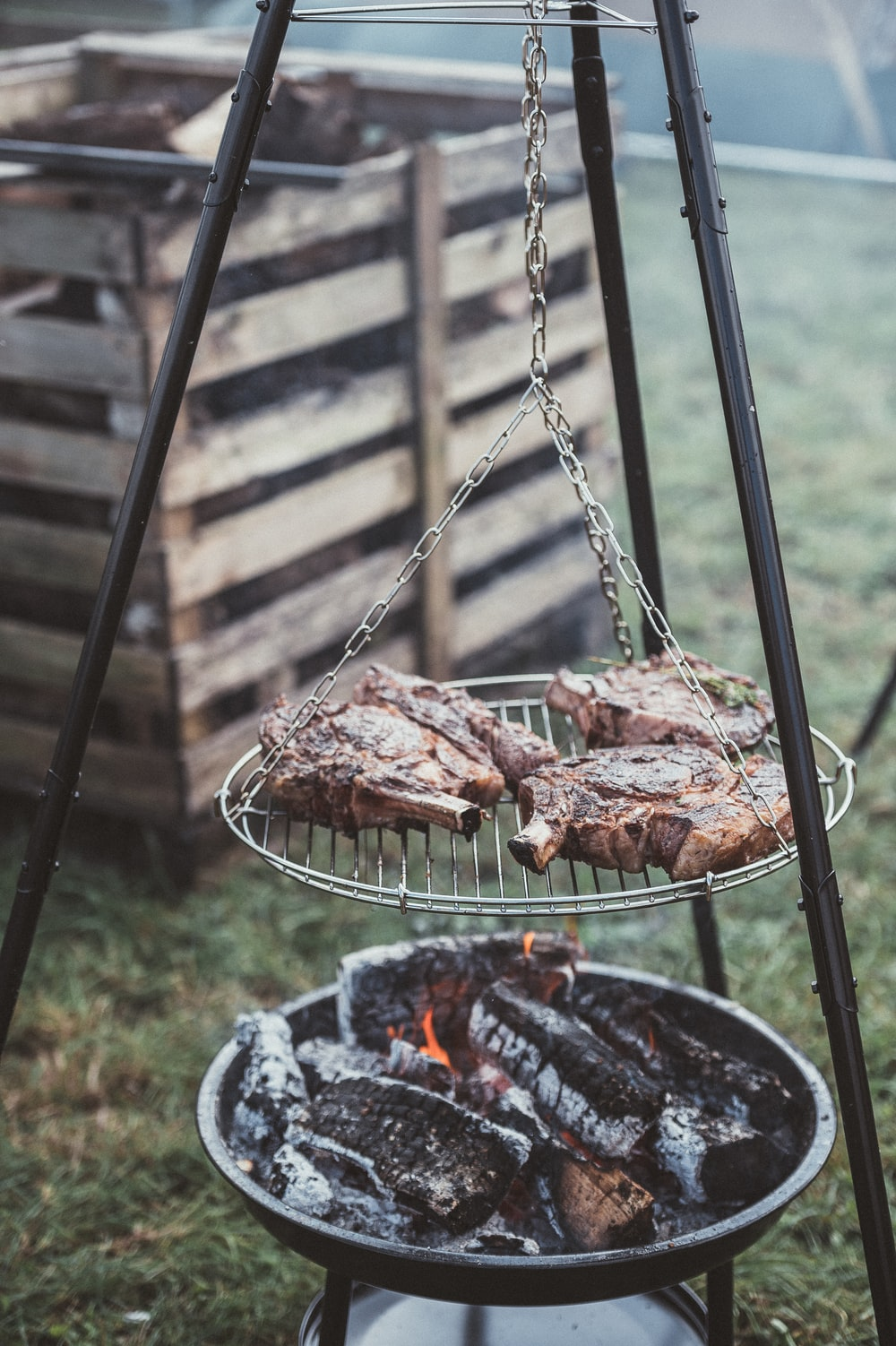 grilling meat during daytime