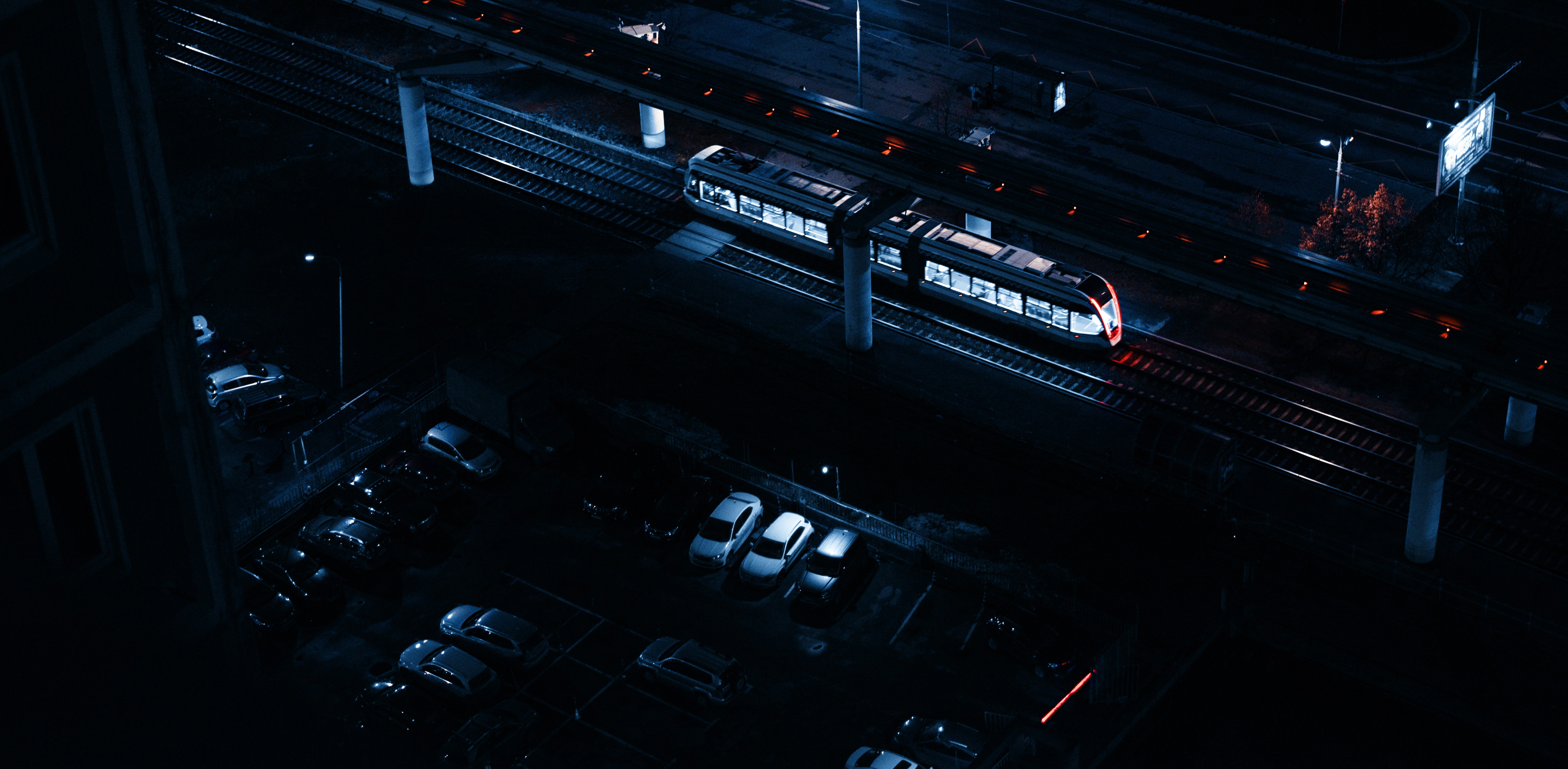 aerial view of piled cars beside train