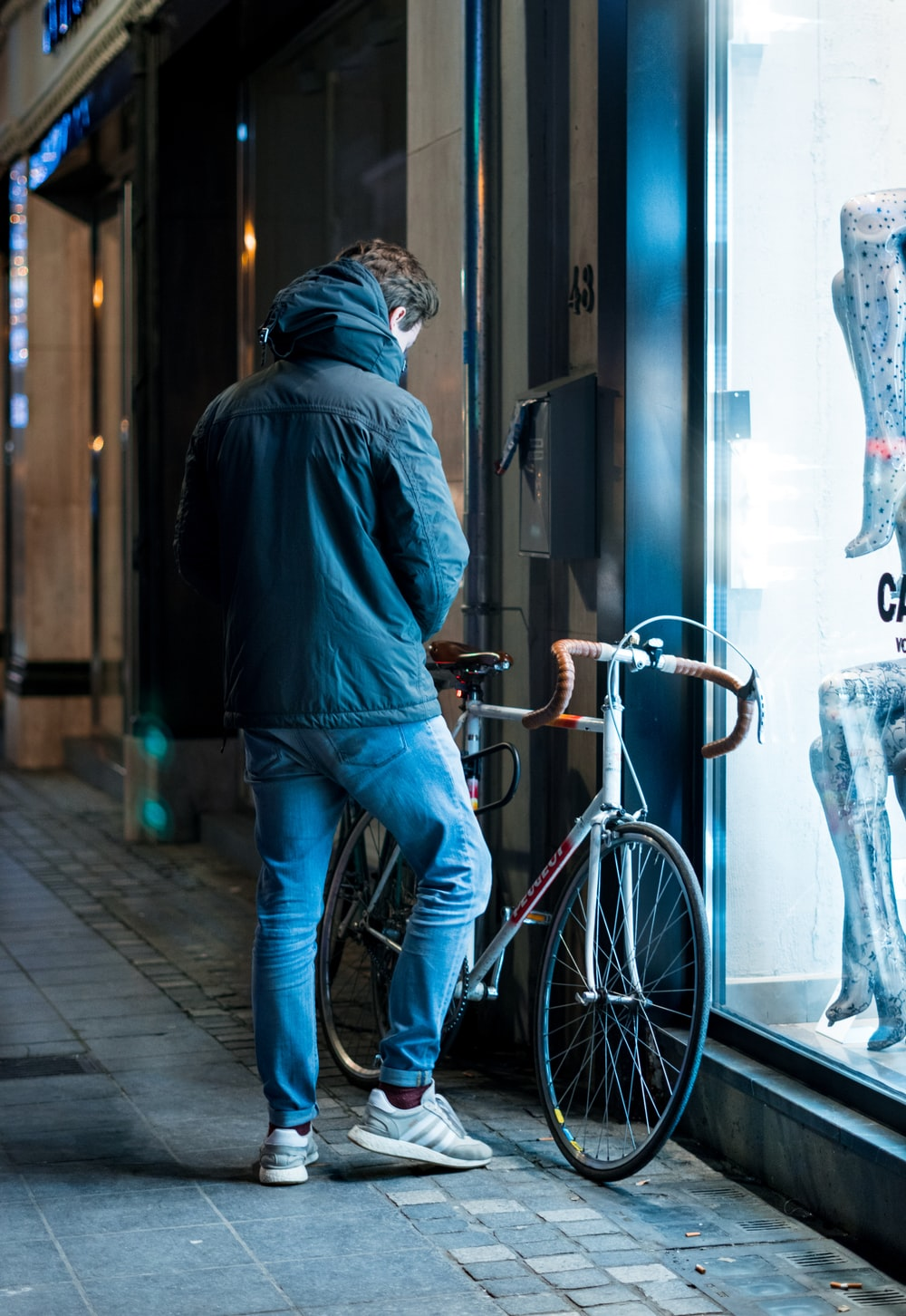 man beside road bicycle