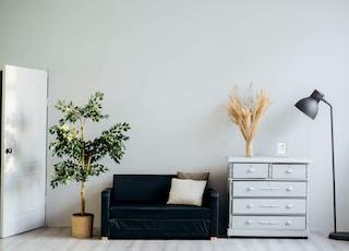 dresser beside sofa