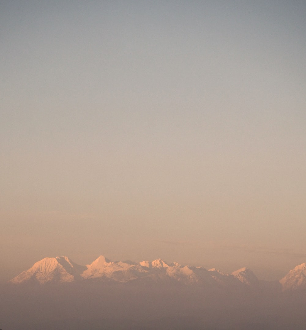mountain alps under nimbus clouds
