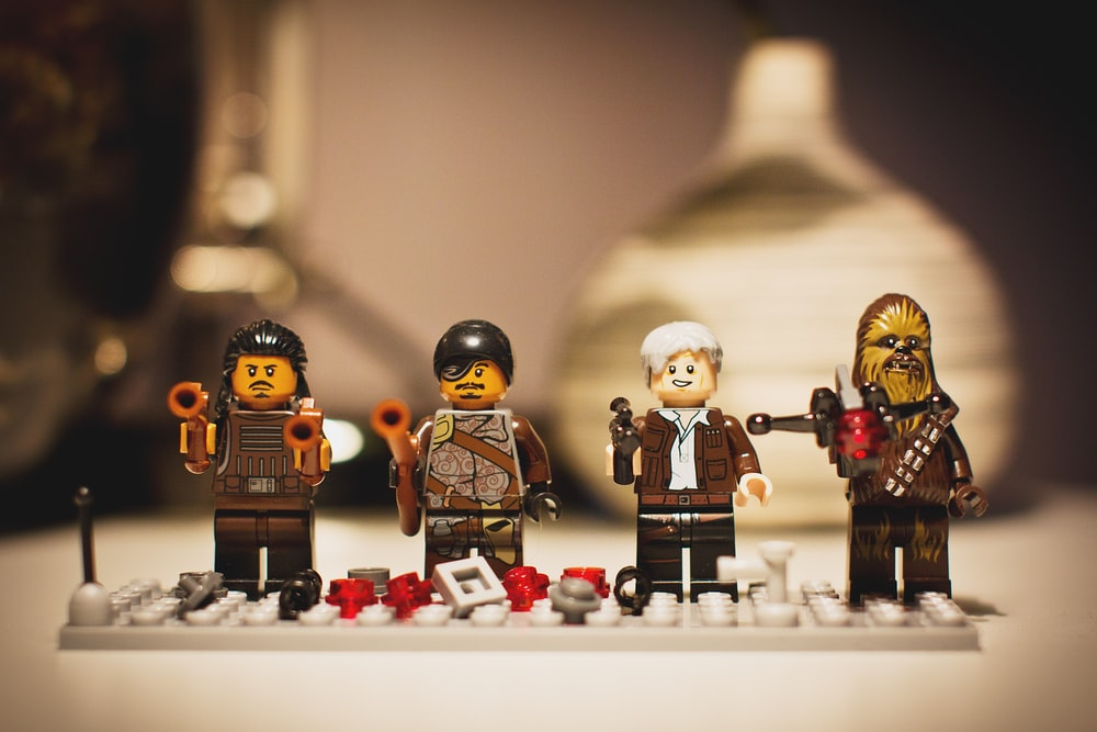 selective focus photography of four LEGO mini figures