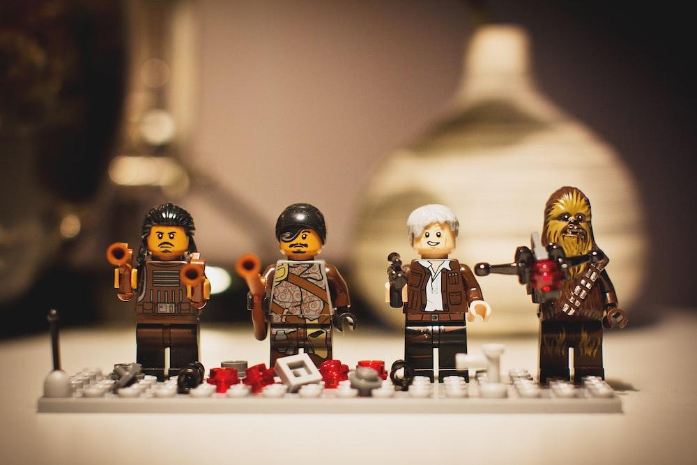 selective focus photography of four LEGO mini figures