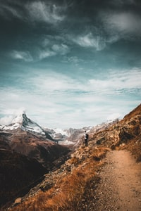 man standing while looking at mountain range