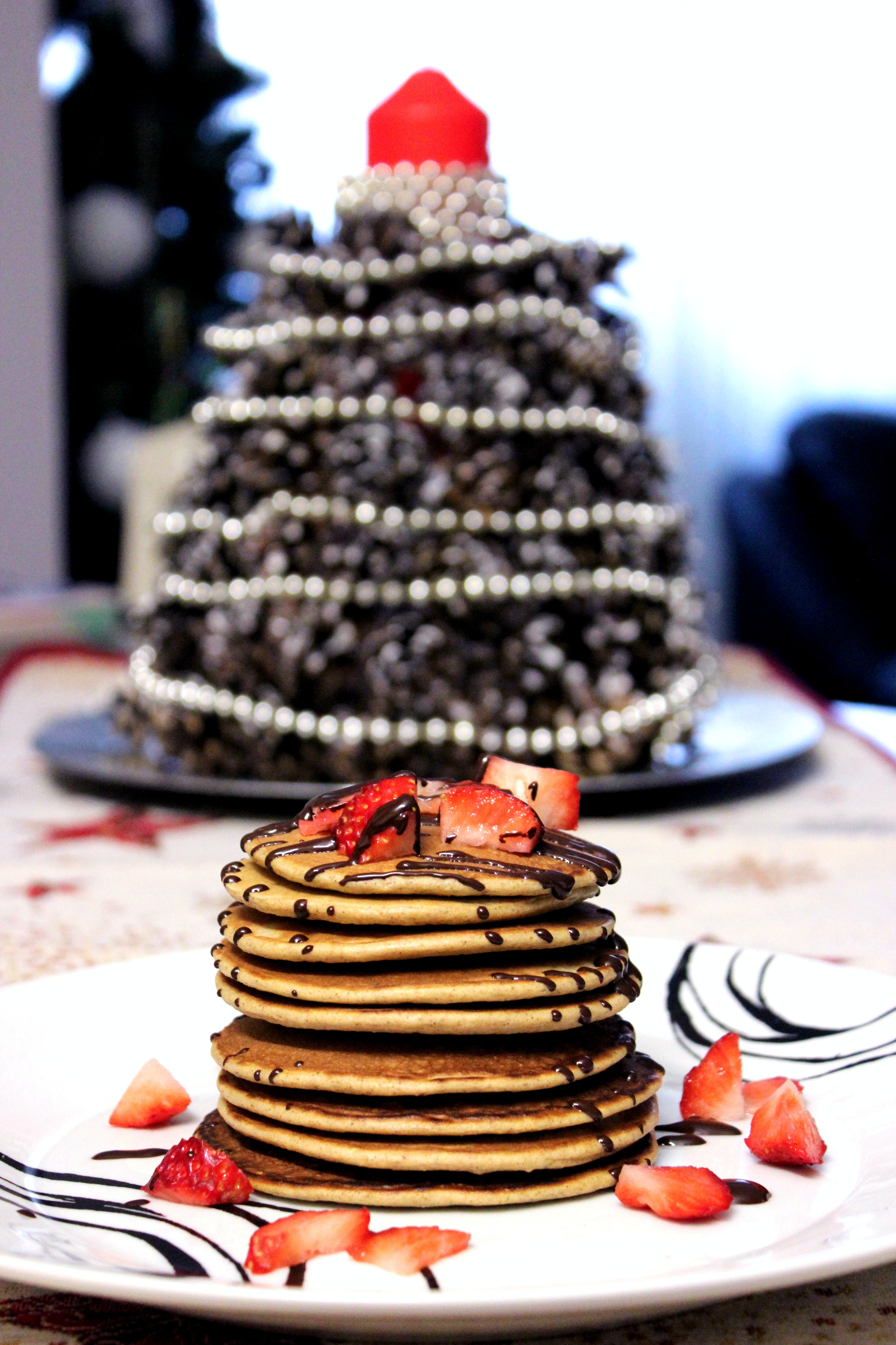 pancakes with chocolate syrup and strawberry toppings