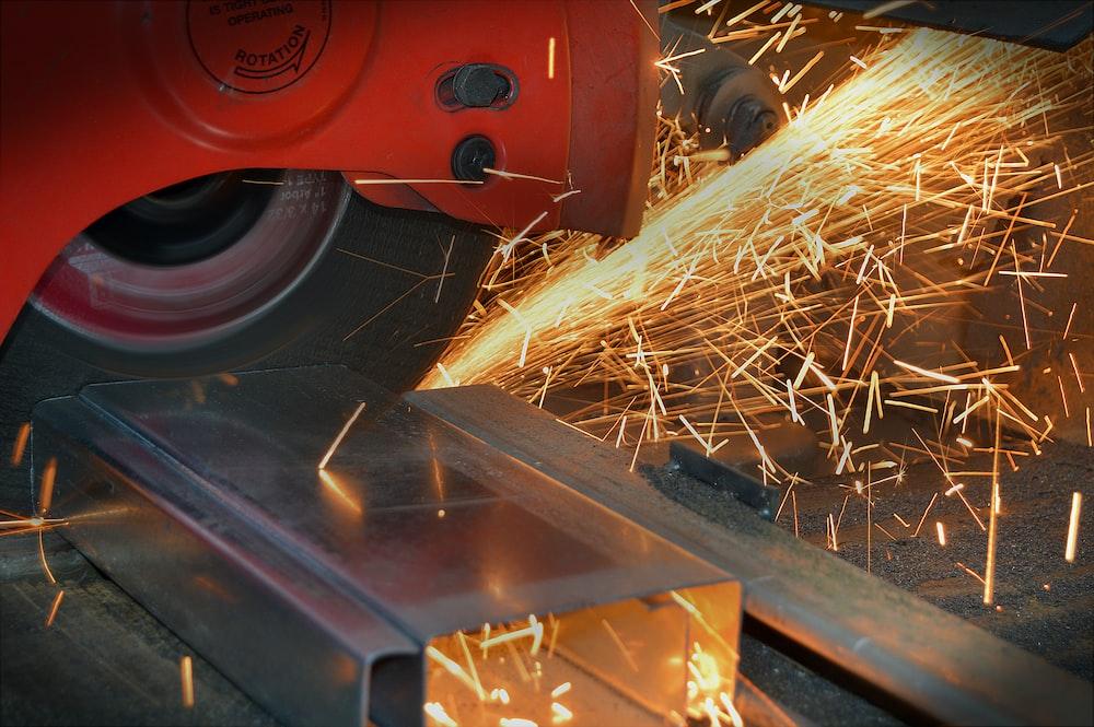red grinder and gray steel frame