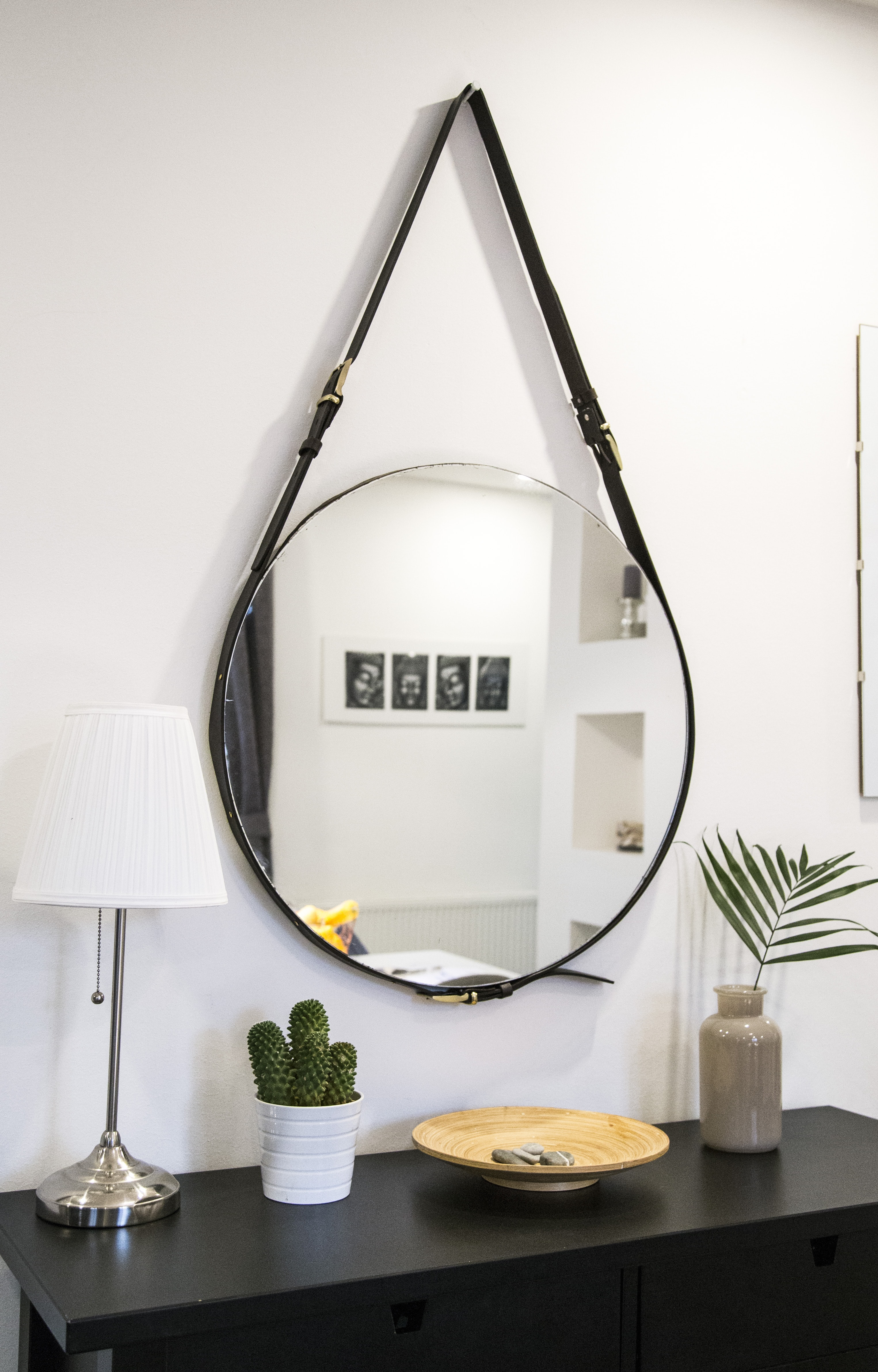 round mirror with black strap