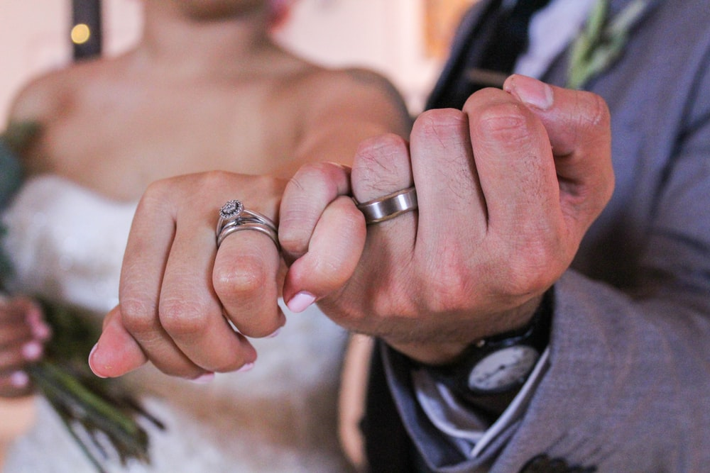 man and woman showing silver-colored rings