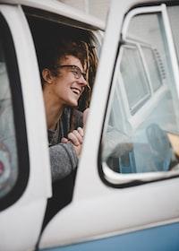 smiling man at the car