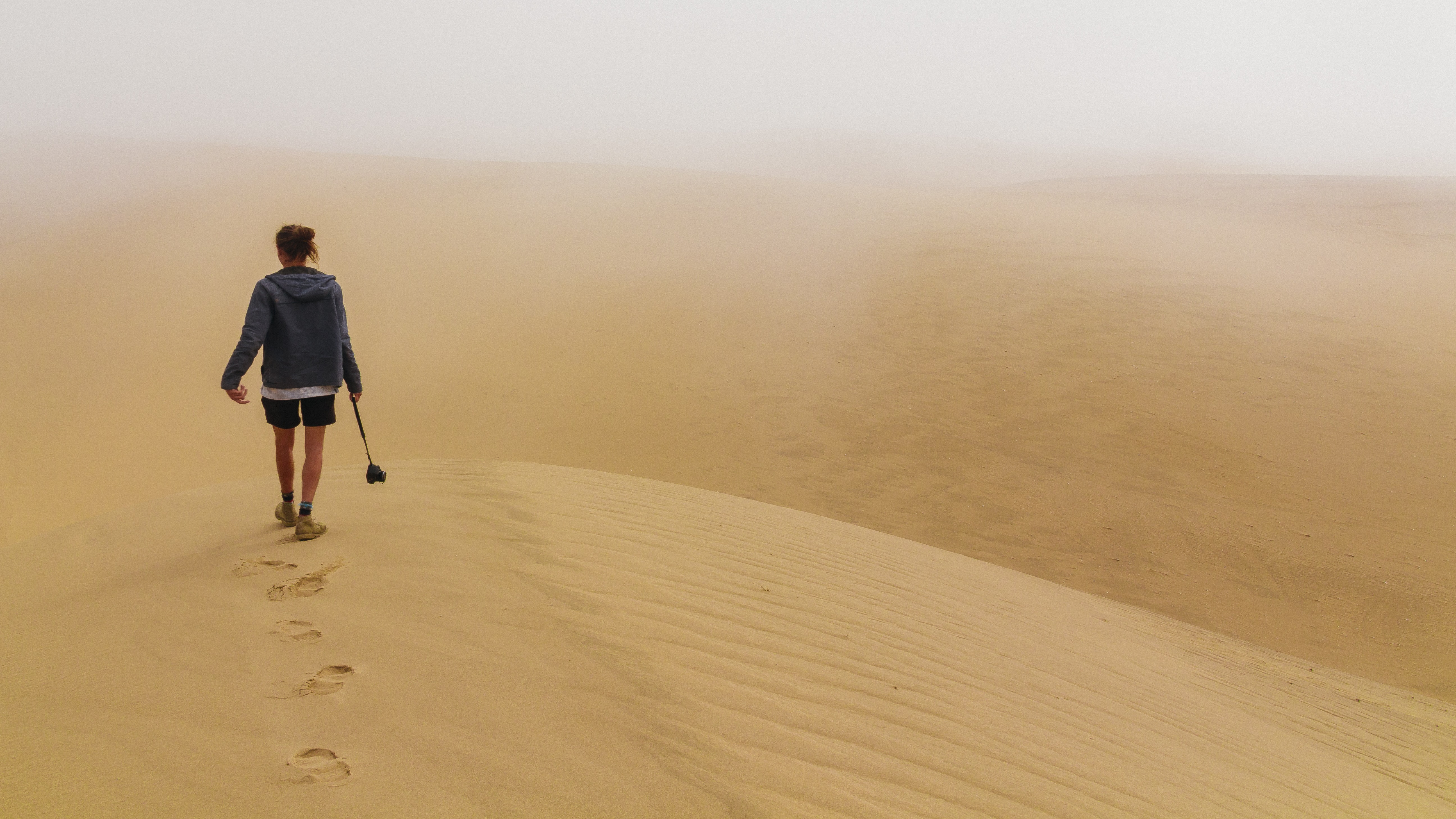 person walking desert place