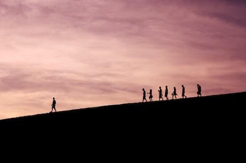 People walking in the dark