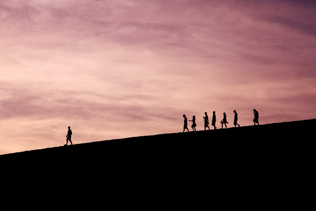 silhouette of people on hill