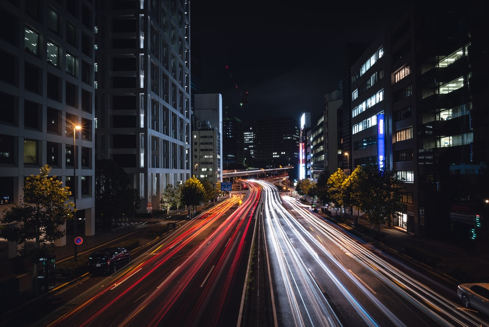 time-lapse photography of road between buildings
